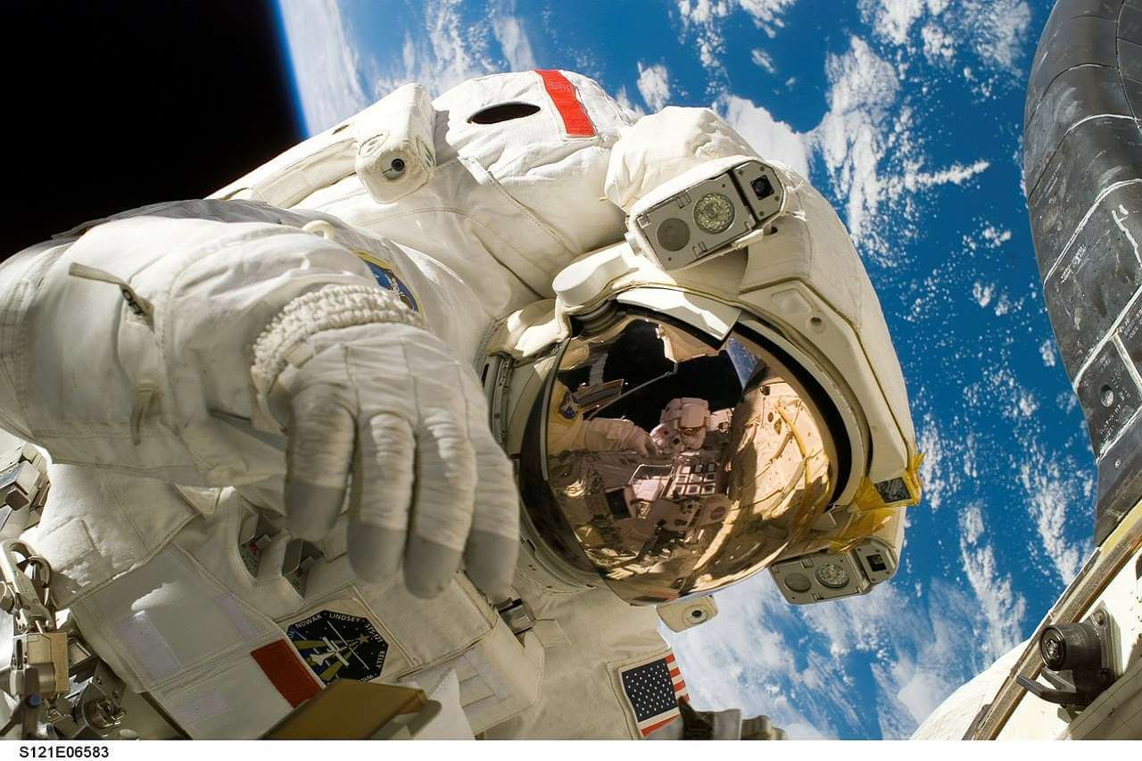 an astronaut in the space against the Earth